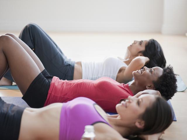 Three women doing crunches