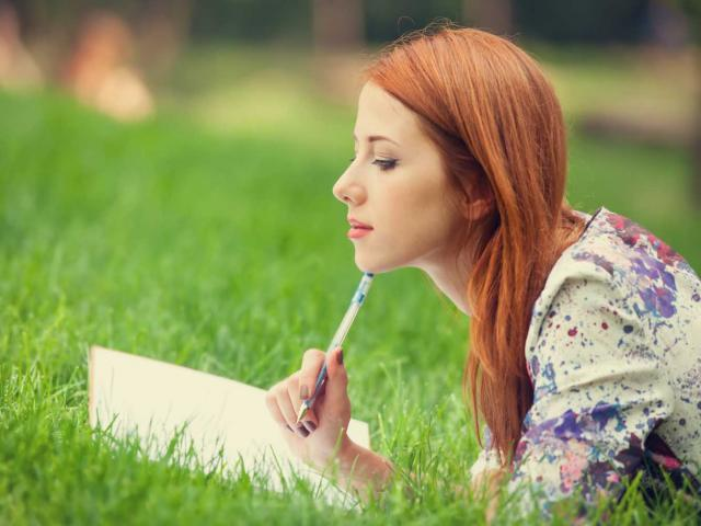 Woman writing outside shutterstock