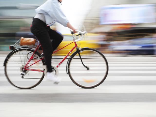 Woman-on-red-bike-getty