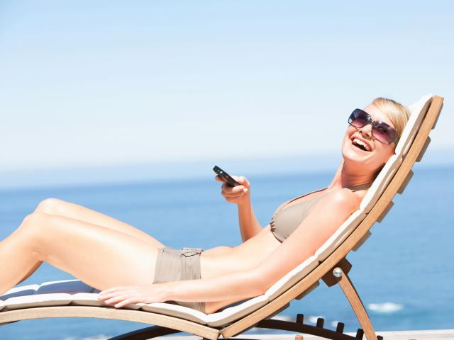 Woman on holiday with her phone