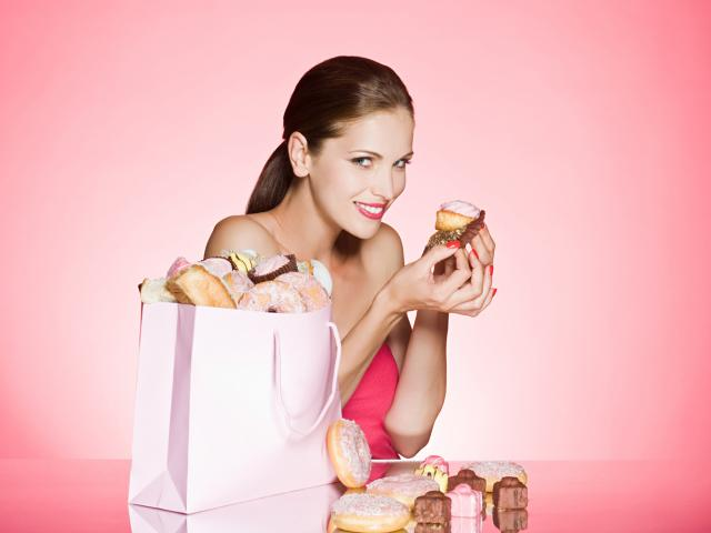Woman eating sugary foods