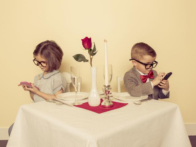 Kid couple at dinner