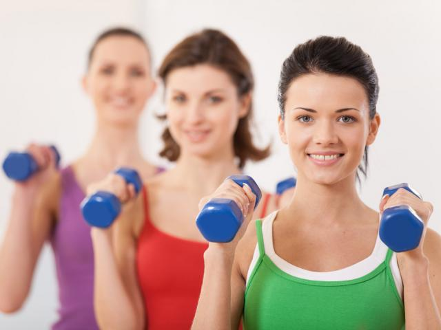 Healthy women with dumbbells