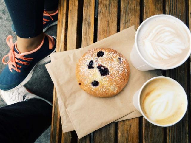 Snacking - woman in trainers having a biscuit and coffee - change behaviour - snack- womens health uk