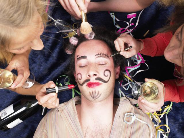 Man asleep having make-up painted on