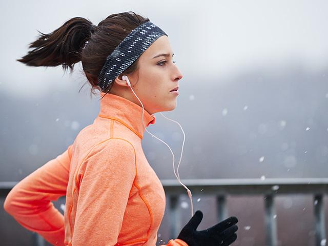 Winter running tips - running in rain - womens health uk