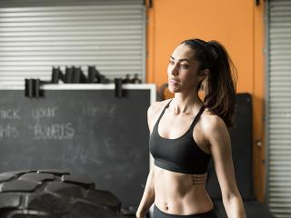 Woman in sports bra after doing best ab exercises