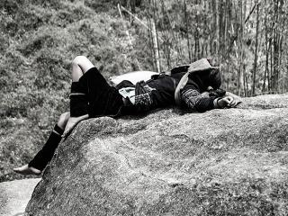 Woman-asleep-outside
