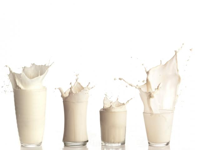 Glasses of milk splash shutterstock