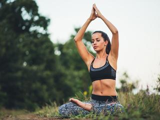 6 things that happened meditation for a month - woman meditating in nature - womens health uk