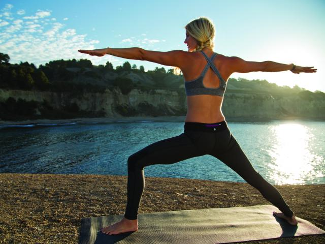 Yoga outdoors by a lake
