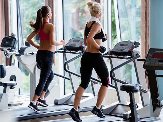 Women running-how to burn more calories on the treadmill- womens health magazine