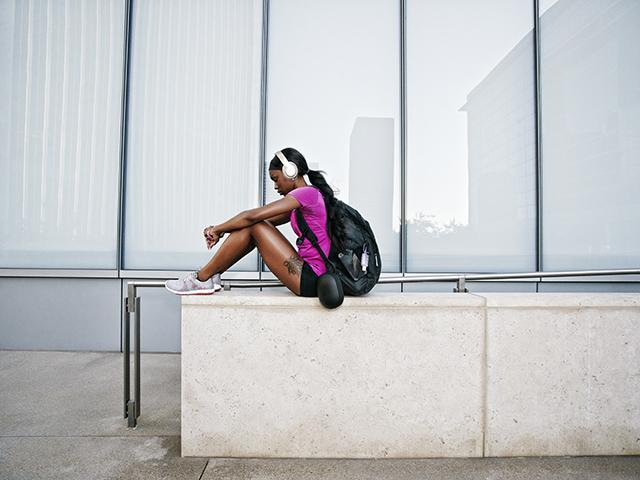 Fit woman sitting - run backpacks - womens health uk
