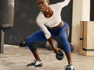 Woman wearing nike metcons best weight lifting trainers