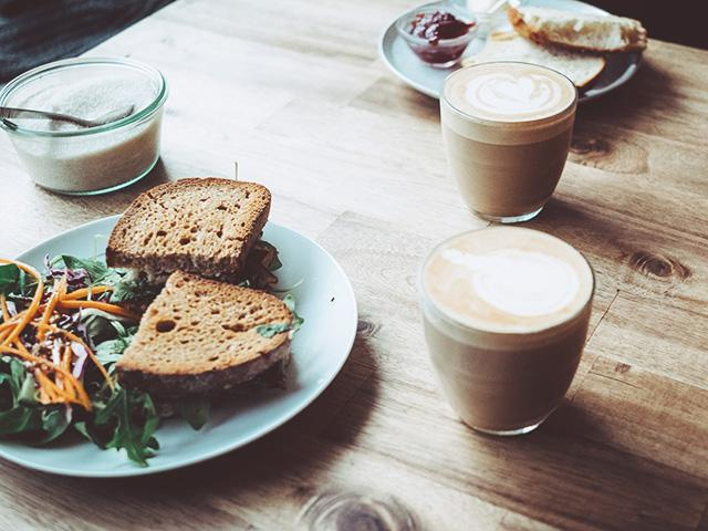 Healthy lunch and two lattes on table - womens health uk