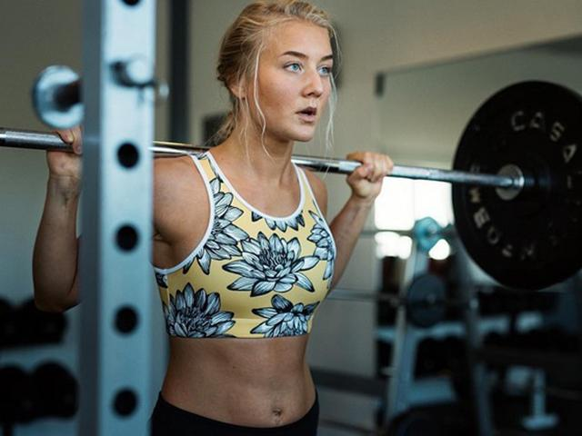 Pretty fitness blogger at the squat rack