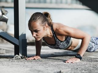 Woman doing a burpee or plank