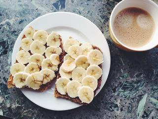 Banana on ryvita breakfast with coffee