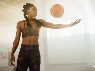 Woman with flat stomach playing basketball