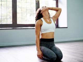 Slim woman stretching in yoga