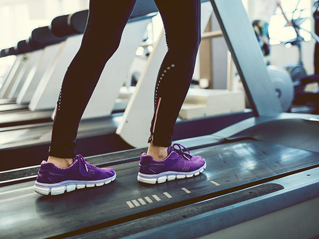 Woman walking on treadmill desk