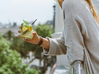 Girl holding a cocktail