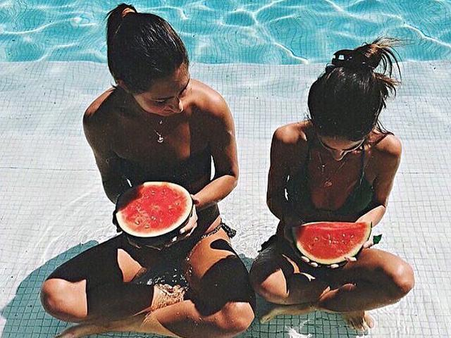 Two Girls In A Pool Eating Watermelon Slices - 8 Foods To Eat Tonight To De-Bloat By Tomorrow - Women's Health UK