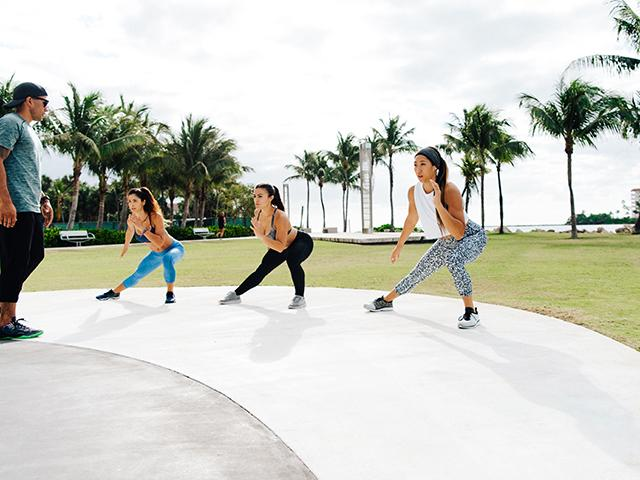 Group of women doin side lunges