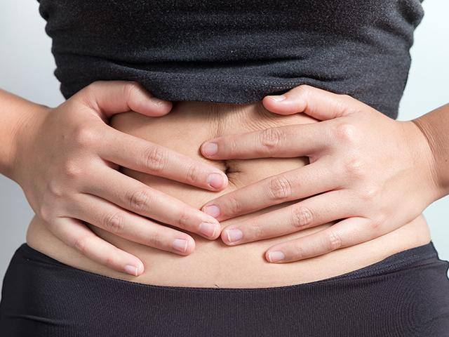 Woman with bloated stomach
