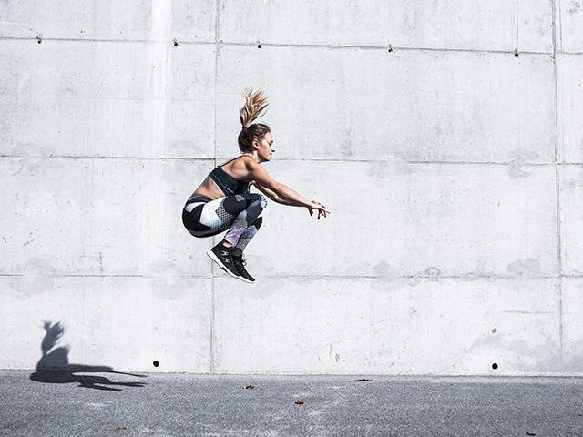 Woman doing jump squat
