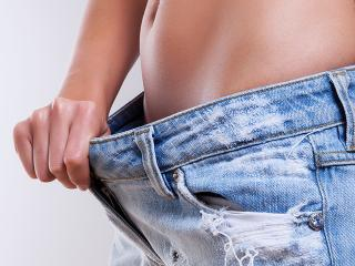 Woman stomach in jeans