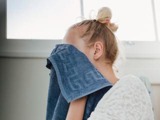 Woman washing face - chin acne causes