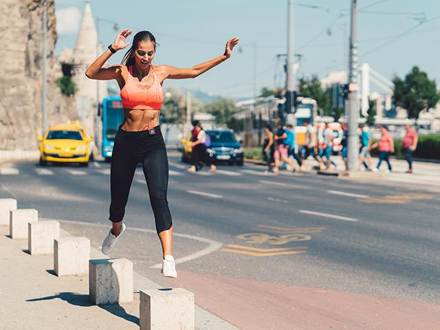 Woman in sports bra - best exercise fat loss
