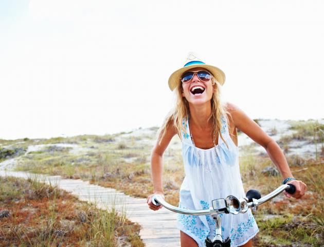 Woman cycling laughing - 157642220