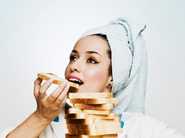 Woman eating toast - 117145928
