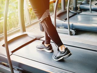 Treadmill workout, woman running on treadmill
