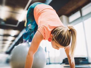 Swiss ball exercises, woman in gym