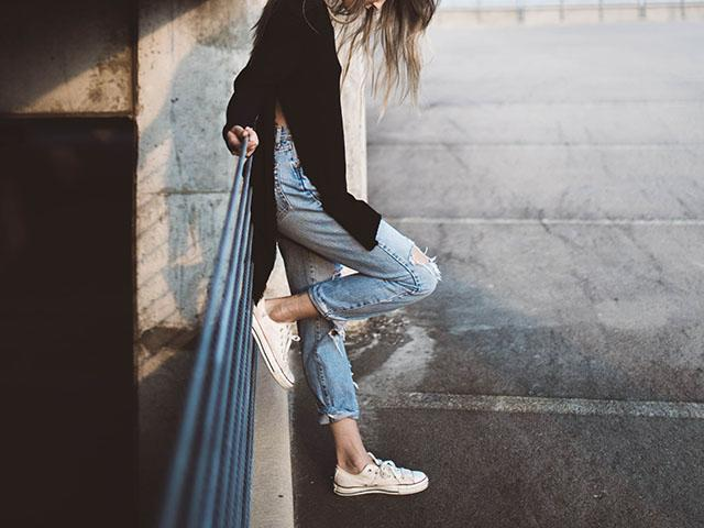How to relieve anxiety, calm woman standing on stairs