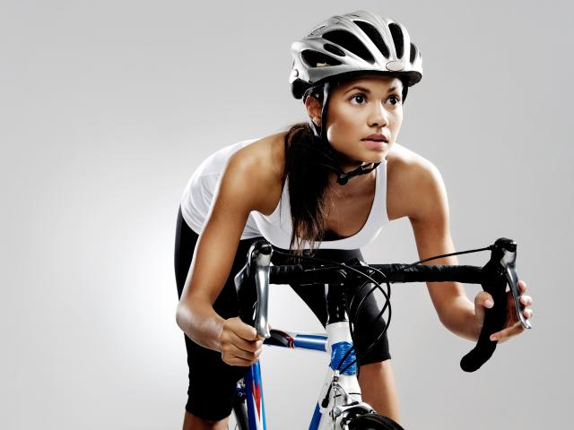Woman on exercise bike shutterstock