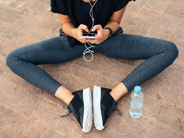 Metabolism boosters, woman exercise phone