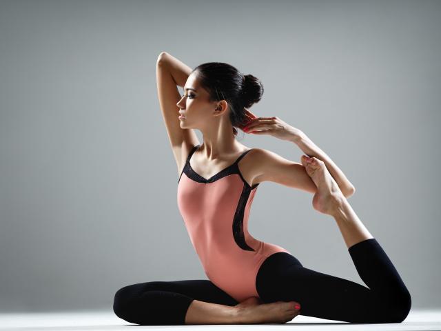 Woman doing yoga shutterstock