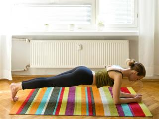Woman doing the plank at home