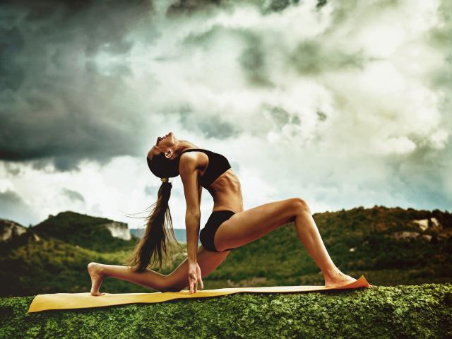 Woman-doing-yoga-shutterstock