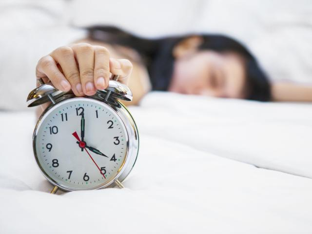 - woman-holding-alarm-clock-shutterstock__medium_4x3